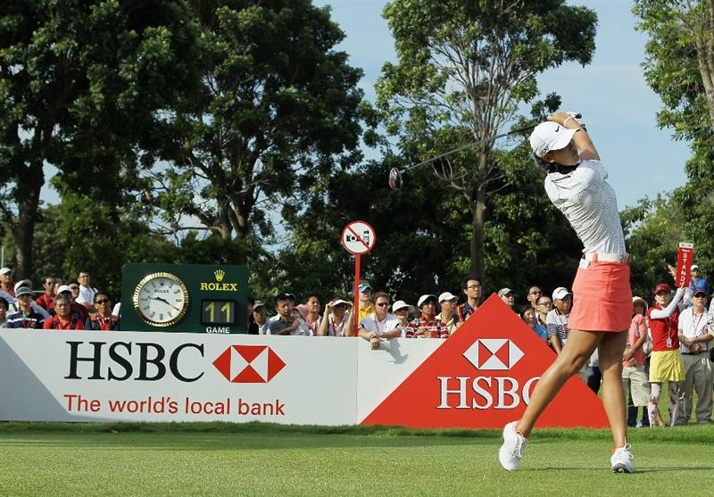 SINGAPORE - FEBRUARY 26:  Michelle Wie of the USA watches her tee shot on the first hole during the third round of the HSBC Women's Champions 2011 at the Tanah Merah Country Club on February 26, 2011 in Singapore, Singapore.  (Photo by Scott Halleran/Getty Images)
