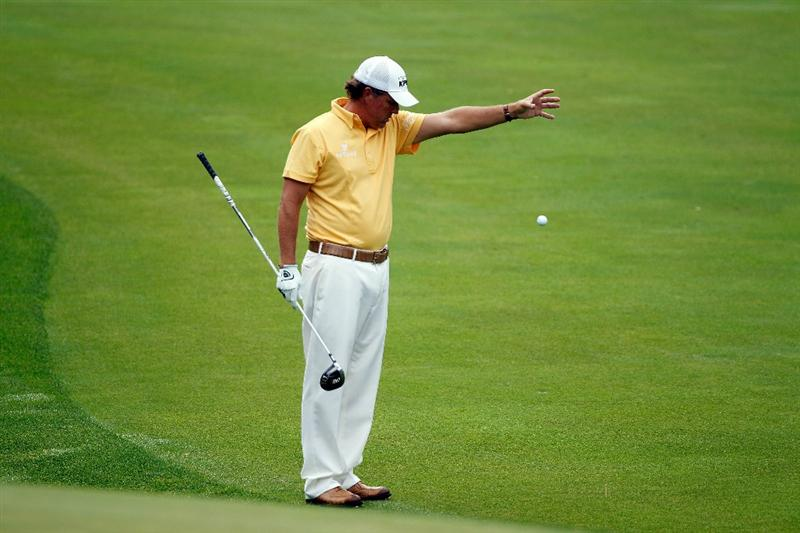 DUBLIN, OH - JUNE 03:  Phil Mickelson drops a golf ball after hitting his approach shot in the water on the 11th hole during the first round of the Memorial Tournament presented by Morgan Stanley at Muirfield Village Golf Club on June 3, 2010 in Dublin, Ohio.  (Photo by Scott Halleran/Getty Images)