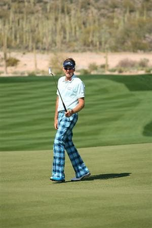 MARANA, AZ - FEBRUARY 19:  Ian Poulter of England reacts to a missed putt on the during round three of the Accenture Match Play Championship at the Ritz-Carlton Golf Club on February 19, 2010 in Marana, Arizona.  (Photo by Hunter Martin/Getty Images)