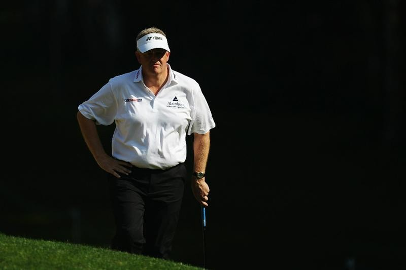 VIRGINIA WATER, ENGLAND - MAY 21:  Colin Montgomerie of Scotland prepares to play an iron shot during the second round of the BMW PGA Championship on the West Course at Wentworth on May 21, 2010 in Virginia Water, England.  (Photo by Ross Kinnaird/Getty Images)