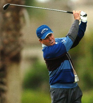 Mark McNulty watches the flight of his shot from the 12th tee during the first round of the Champions' Tour 2005  Toshiba Senior Classic at the Newport Beach Country Club in Newport Beach, California March 18, 2005.