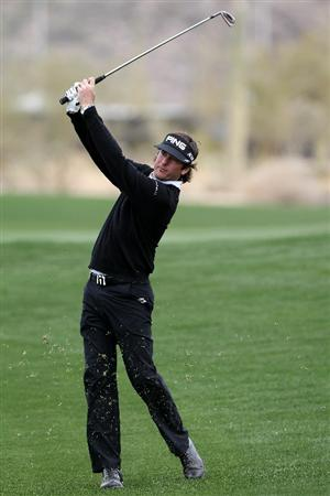 MARANA, AZ - FEBRUARY 26:  Bubba Watson hits an approach shot on the fifth hole during the semifinal round of the Accenture Match Play Championship at the Ritz-Carlton Golf Club on February 26, 2011 in Marana, Arizona.  (Photo by Sam Greenwood/Getty Images)