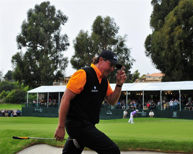 PACIFIC PALISADES, CA - FEBRUARY 21:  Phil Mickelson of USA celebrates his bunker on the 17th hole during the third round of the Northern Trust Open at the Riviera Country Club February 21, 2009 in Pacific Palisades, California.  (Photo by Stuart Franklin/Getty Images)