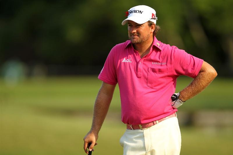 PONTE VEDRA BEACH, FL - MAY 12:  Graeme McDowell of Northern Ireland looks on from the sixth green after holing out for birdie during the first round of THE PLAYERS Championship held at THE PLAYERS Stadium course at TPC Sawgrass on May 12, 2011 in Ponte Vedra Beach, Florida.  (Photo by Mike Ehrmann/Getty Images)