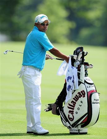 AKRON, OH - AUGUST 07:  Prayad Marksaeng of Thailand cleans his club during the second round of the World Golf Championship Bridgestone Invitational on August 7, 2009 at Firestone Country Club in Akron, Ohio.  (Photo by Stuart Franklin/Getty Images)