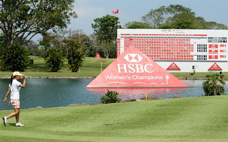 SINGAPORE - FEBRUARY 28:  Ai Miyazato of Japan waves as she approaches the 18th green on her way to victory in the HSBC Women's Champions at the Tanah Merah Country Club on February 28, 2010 in Singapore.  (Photo by Andrew Redington/Getty Images)
