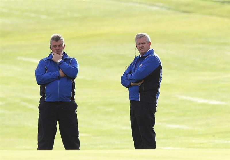 NEWPORT, WALES - OCTOBER 02:  Vice Captain of Europe Darren Clarke (L) looks on with Team Captain Colin Montgomerie during the rescheduled Morning Fourball Matches during the 2010 Ryder Cup at the Celtic Manor Resort on October 2, 2010 in Newport, Wales.  (Photo by Ross Kinnaird/Getty Images)