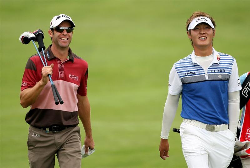 CRANS, SWITZERLAND - SEPTEMBER 03:  Bradley Dredge of Wales (L) shares a joke with Danny Lee of New Zealand on the 12th hole during the first round of The Omega European Masters at Crans-Sur-Sierre Golf Club on September 3, 2009 in Crans Montana, Switzerland.  (Photo by Andrew Redington/Getty Images)