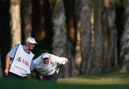 HONG KONG - NOVEMBER 15:  Garry Houston of Wales and caddie discuss his chip shot on the eighth hole during the first round of the UBS Hong Kong Open at the Hong Kong Golf Club on November 15, 2007 in Fanling, Hong Kong.  (Photo by Stuart Franklin/Getty Images)
