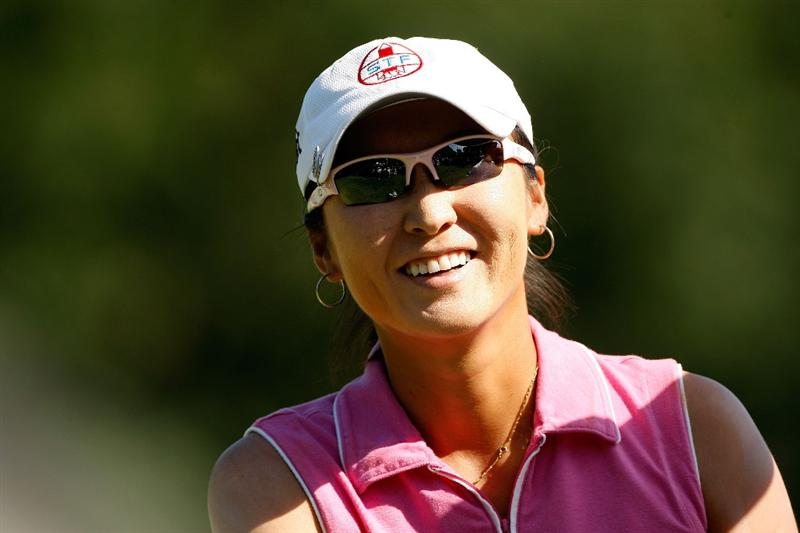 BETHLEHEM, PA - JULY 12:  Candie Kung of Taiwan smiles after making par on the 15th hole during the final round of the 2009 U.S. Women's Open at Saucon Valley Country Club on July 12, 2009 in Bethlehem, Pennsylvania.  (Photo by Chris Graythen/Getty Images)