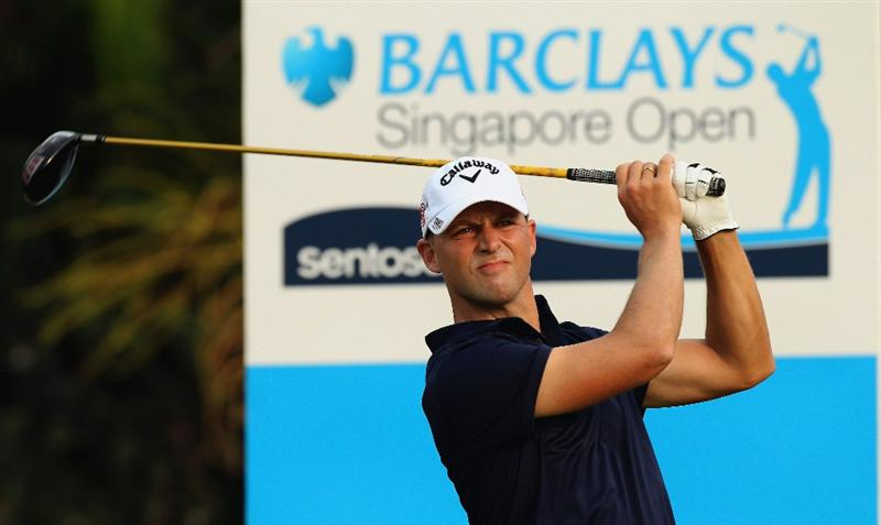 SINGAPORE - NOVEMBER 11: Niclas Fasth of Sweden follows through his tee shot on the 1st hole during the First Round of the Barclays Singapore Open at Sentosa Golf Club on November 11, 2010 in Singapore, Singapore.  (Photo by Stanley Chou/Getty Images)