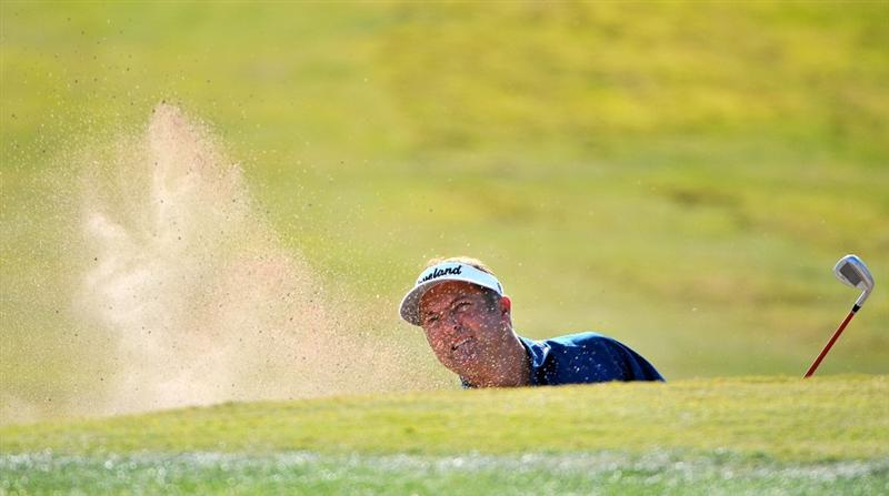 LAS VEGAS- OCTOBER 17:  Ken Duke hits out of the greenside bunker on the 11th hole during the third round of the Justin Timberlake Shriners Hospitals for Children Open held at the TPC Summerlin on Saturday, October 18, 2008 in Las Vegas, Nevada(Photo by Marc Feldman/Getty Images)