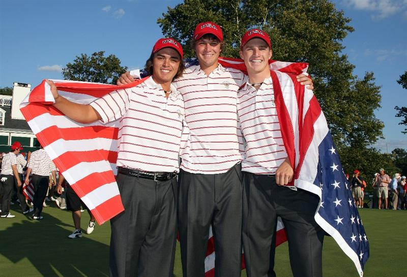 ARDMORE, PA - SEPTEMBER 13:  Rickie Fowler, Peter Uihlein and Morgan Hoffman of the USA celebrate on the 18th green after the USA had secured victory, (all three are members of the Oklahoma State University golf team) during the final afternoon singles matches on the East Course at Merion Golf Club on September 13, 2009 in Ardmore, Pennsylvania  (Photo by David Cannon/Getty Images)