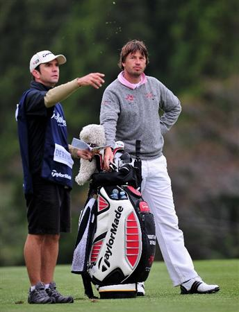 JEJU, SOUTH KOREA - APRIL 24:  Robert - Jan Derksen of The Netherlands and caddie discuss his approach shot on the 15th hole during the second round of the Ballantine's Championship at Pinx Golf Club on April 24, 2009 in Jeju, South Korea.  (Photo by Stuart Franklin/Getty Images)