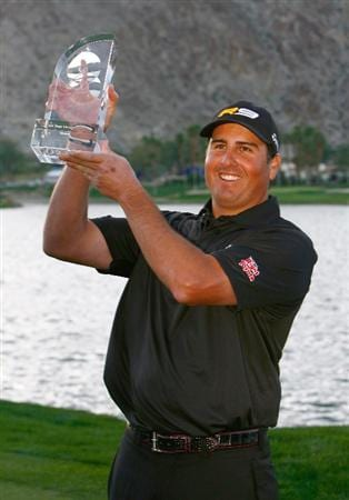 LA QUINTA, CA - JANUARY 25:  Pat Perez poses with the trophy after winning the Bob Hope Chrysler Classic at the Palmer Course at PGA West on January 25, 2009 in La Quinta, California.  (Photo by Jeff Gross/Getty Images)