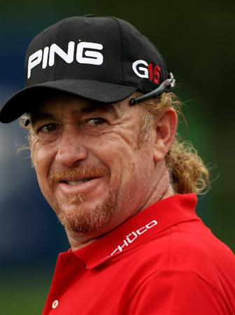 DUBAI, UNITED ARAB EMIRATES - FEBRUARY 06:  Miguel Angel Jimenez of Spain smiles on the ninth hole during the third round of the Omega Dubai Desert Classic on February 6, 2010 in Dubai, United Arab Emirates.  (Photo by Andrew Redington/Getty Images)