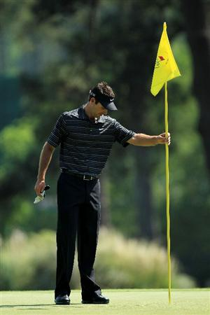 AUGUSTA, GA - APRIL 10:  Charl Schwartzel of South Africa looks down at his golf ball after holing a shot for eagle on the third green during the final round of the 2011 Masters Tournament on April 10, 2011 in Augusta, Georgia.  (Photo by David Cannon/Getty Images)