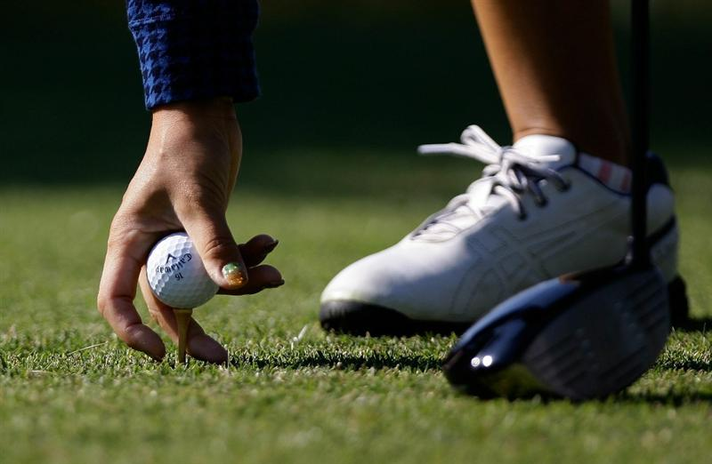SHIMA, JAPAN - NOVEMBER 06: Momoko Ueda of Japan put the ball on the 2nd teeing ground during round two of the Mizuno Classic at Kintetsu Kashikojima Country Club on November 6, 2010 in Shima, Japan.  (Photo by Chung Sung-Jun/Getty Images)