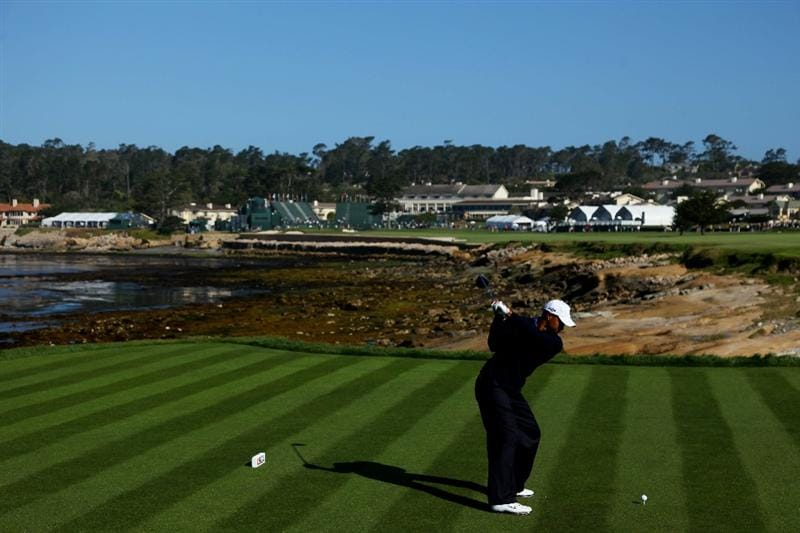 PEBBLE BEACH, CA - JUNE 16:  Tiger Woods hits a tee shot during a practice round prior to the start of the 110th U.S. Open at Pebble Beach Golf Links on June 16, 2010 in Pebble Beach, California.  (Photo by Donald Miralle/Getty Images)