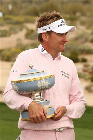 MARANA, AZ - FEBRUARY 21:  Ian Poulter of England lifts the Walter Hagen Cup trophy on the 16th hole after winning the final round of the Accenture Match Play Championship at the Ritz-Carlton Golf Club at  on February 21, 2010 in Marana, Arizona.  (Photo by Darren Carroll/Getty Images)