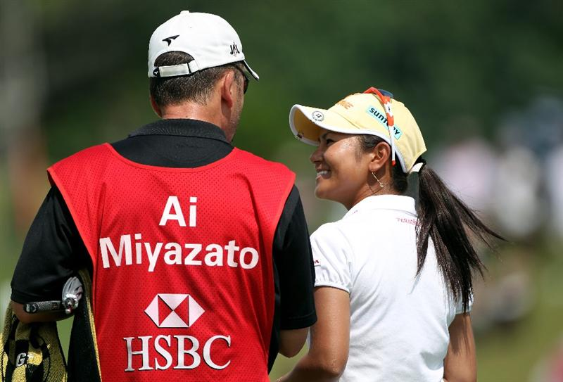 SINGAPORE - FEBRUARY 28:  Ai Miyazato of Japan celebrates with her caddie on the 18th green after winning the HSBC Women's Champions at the Tanah Merah Country Club on February 28, 2010 in Singapore.  (Photo by Andrew Redington/Getty Images)