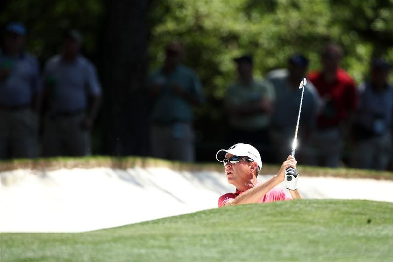 AUGUSTA, GA - APRIL 07:  Davis Love III plays a bunker shot on the first hole during the first round of the 2011 Masters Tournament at Augusta National Golf Club on April 7, 2011 in Augusta, Georgia.  (Photo by Andrew Redington/Getty Images)