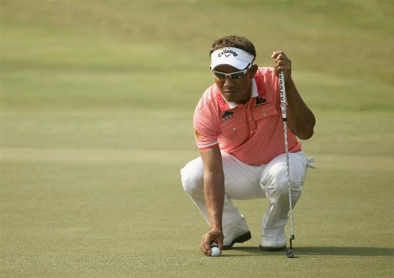 NEW DELHI, INDIA - FEBRUARY 19:  Thongchai Jaidee of Thailand lines up a putt on the 17th green during the second round of the Avantha Masters held at The DLF Golf and Country Club on February 19, 2011 in New Delhi, India.  (Photo by Ian Walton/Getty Images)