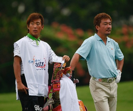 JAKARTA, INDONESIA - FEBRUARY 14:  Mitsuhiro Tateyama of Japan and caddie on the 13th hole during the first round of the 2008 Enjoy Jakarta Astro Indonesian Open at the Cengkareng Golf Club on February 14, 2008 in Jakarta, Indonesia.  (Photo by Stuart Franklin/Getty Images)