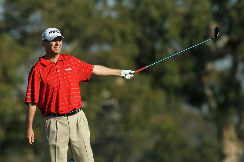 LA JOLLA, CA - JANUARY 29:  Kevin Sutherland signals after his tee shot on the second hole during round three of the Farmers Insurance Open at Torrey Pines South Course on January 29, 2011 in La Jolla, California.  (Photo by Stephen Dunn/Getty Images)