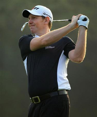DUBAI, UNITED ARAB EMIRATES - FEBRUARY 10:  Stephen Gallacher of Scotland in action during the first round of the Omega Dubai Desert Classic on the Majlis course at the Emirates Golf Club on February 10, 2011 in Dubai, United Arab Emirates.  (Photo by Andrew Redington/Getty Images)