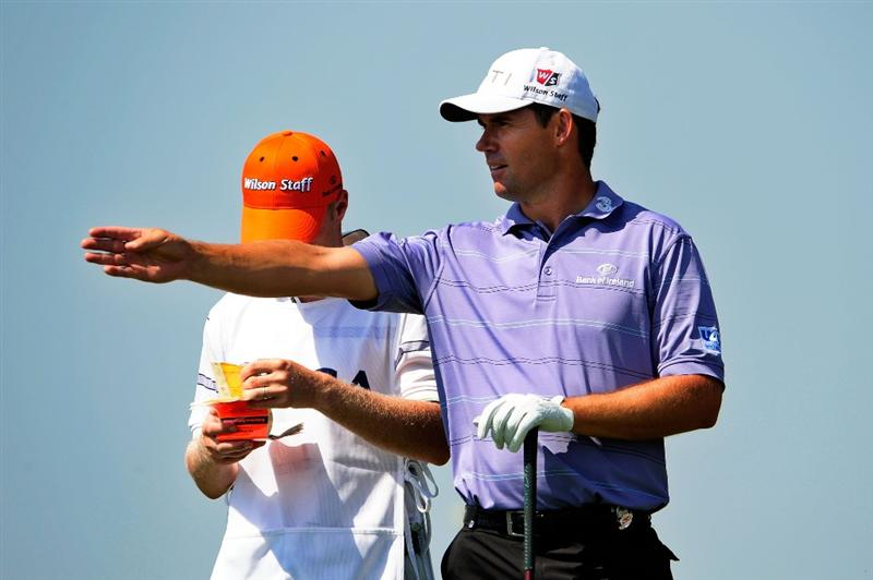 CHASKA, MN - AUGUST 14:  Padraig Harrington of Ireland  chats with his caddie Ronan Flood on the first tee during the second round of the 91st PGA Championship at Hazeltine National Golf Club on August 14, 2009 in Chaska, Minnesota.  (Photo by Sam Greenwood/Getty Images)