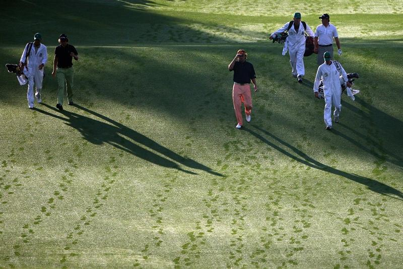 AUGUSTA, GA - APRIL 10:  The group of Aaron Baddeley of Australia, Bubba Watson and Graeme McDowell of Northern Ireland make their way up the first fairway with their caddies during the second round of the 2009 Masters Tournament at Augusta National Golf Club on April 10, 2009 in Augusta, Georgia.  (Photo by Andrew Redington/Getty Images)