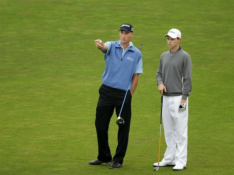 PEBBLE BEACH, CA - JUNE 14:  Jim Furyk (L) points out a target for amateur Kevin Phelan during a practice round prior to the start of the 110th U.S. Open at Pebble Beach Golf Links on June 14, 2010 in Pebble Beach, California.  (Photo by Andrew Redington/Getty Images)
