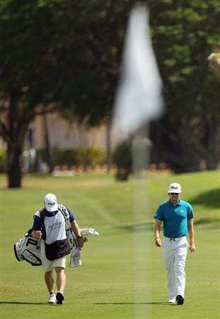 DORAL, FL - MARCH 12:  Hunter Mahan walks with his caddie John Wood to the first green during the third round of the 2011 WGC- Cadillac Championship at the TPC Blue Monster at the Doral Golf Resort and Spa on March 12, 2011 in Doral, Florida.  (Photo by Mike Ehrmann/Getty Images)