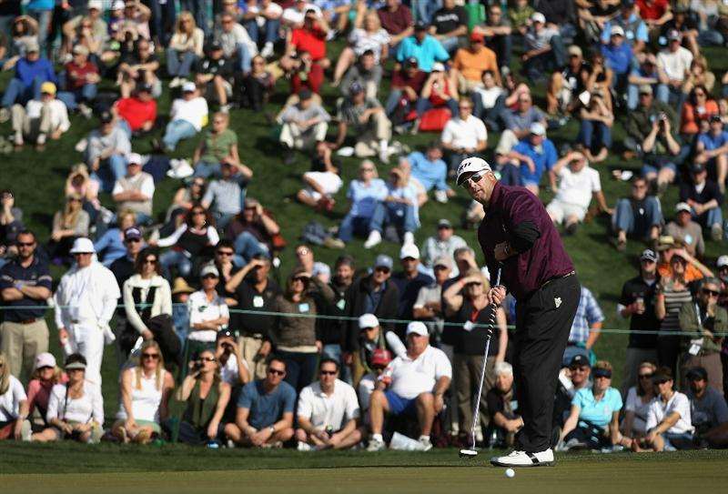 SCOTTSDALE, AZ - FEBRUARY 06:  Chris Couch putts on the second hole green during the final round of the Waste Management Phoenix Open at TPC Scottsdale on February 6, 2011 in Scottsdale, Arizona.  (Photo by Christian Petersen/Getty Images)