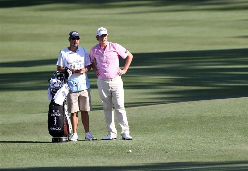 PALM HARBOR, FL - MARCH 19:  Webb Simpson and caddie Paul Tesori look over a shot on the 18th hole during the third round of the Transitions Championship at Innisbrook Resort and Golf Club on March 19, 2011 in Palm Harbor, Florida.  (Photo by Sam Greenwood/Getty Images)