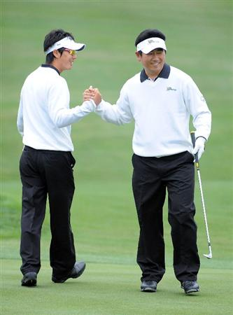 SAN FRANCISCO - OCTOBER 10:  Ryo Ishikawa (L) and Y.E. Yang of the International Team celebrate a birdie on the first hole during the Day Three Morning Foursome Matches of The Presidents Cup at Harding Park Golf Course on October 10, 2009 in San Francisco, California.  (Photo by Harry How/Getty Images)