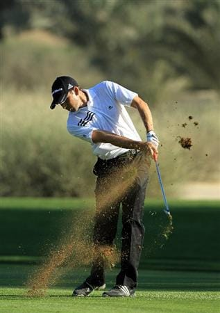 DUBAI, UNITED ARAB EMIRATES - FEBRUARY 12:  Sergio Garcia of Spain plays his second shot on the 16th hole during the third round of the 2011 Omega Dubai Desert Classic on the Majilis Course at the Emirates Golf Club on February 12, 2011 in Dubai, United Arab Emirates.  (Photo by David Cannon/Getty Images)