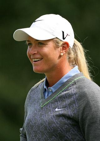 CALGARY, AB - SEPTEMBER 04 : Suzann Pettersen of Norway smiles as she stands on the ninth green during the second round of the Canadian Women's Open at Priddis Greens Golf & Country Club on September 4, 2009 in Calgary, Alberta, Canada. (Photo by Hunter Martin/Getty Images)