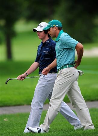AKRON, OH - AUGUST 05:  Rory McIlroy of Northern Ireland and Sergio Garcia of Spain walk together during a practice round of the World Golf Championship Bridgestone Invitational on August 5, 2009 at Firestone Country Club in Akron, Ohio.  (Photo by Stuart Franklin/Getty Images)