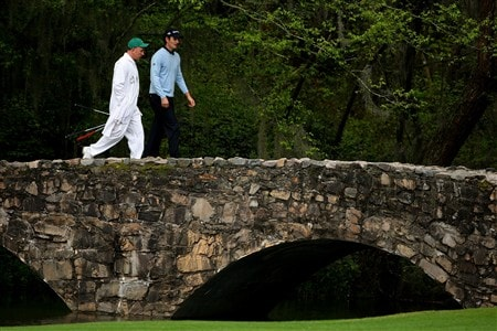 AUGUSTA, GA - APRIL 08:  Justin Rose of England walks over the Byron Nelson bridge with his caddie during the second day of practice prior to the start of the 2008 Masters Tournament at Augusta National Golf Club on April 8, 2008 in Augusta, Georgia.  (Photo by Andrew Redington/Getty Images)