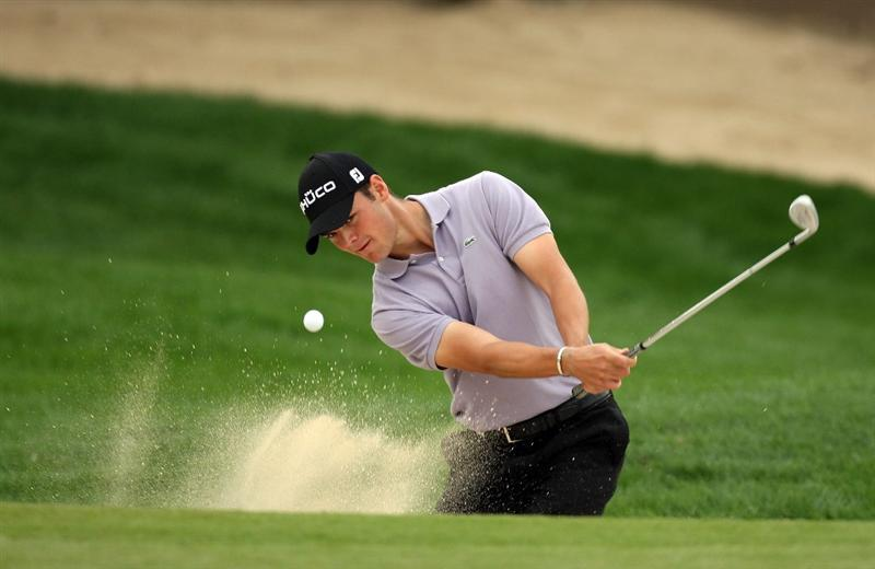 ABU DHABI, UNITED ARAB EMIRATES - JANUARY 18:  Martin Kaymer of Germany hits his third shot at the 11th hole during the final round of the Abu Dhabi Golf Championship held at the Abu Dhabi Golf Club on January 18, 2009 in Abu Dhabi, United Arab Emirates  (Photo by David Cannon/Getty Images)