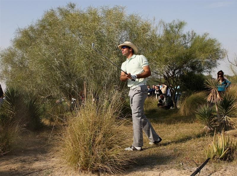 DOHA, QATAR - JANUARY 24:  Alvaro Quiros of Spain plays watches his second shot on the ninth hole during the third round of  the Commercialbank Qatar Masters at Doha Golf Club on January 24, 2009 in Doha, Qatar.  (Photo by Andrew Redington/Getty Images)