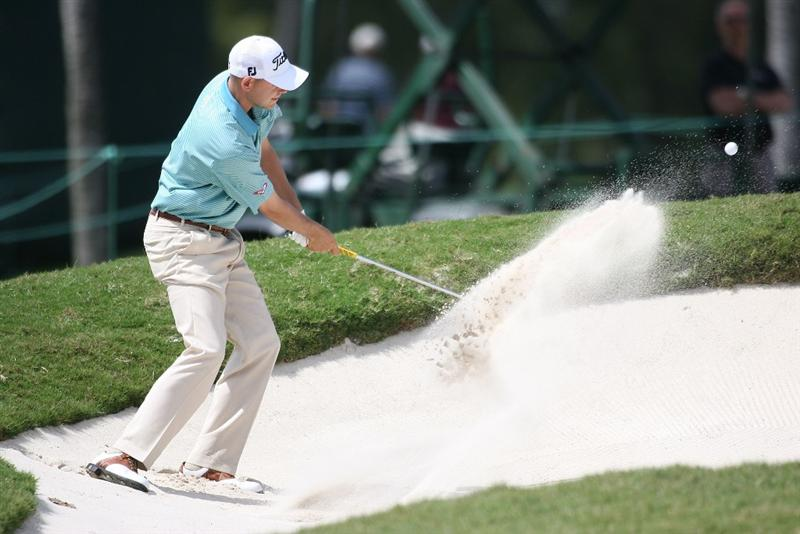 DORAL, FL - MARCH 14:  Bill Haas hits out of the bunker on the first hole during the final round of the 2010 WGC-CA Championship at the TPC Blue Monster at Doral on March 14, 2010 in Doral, Florida.  (Photo by Marc Serota/Getty Images)
