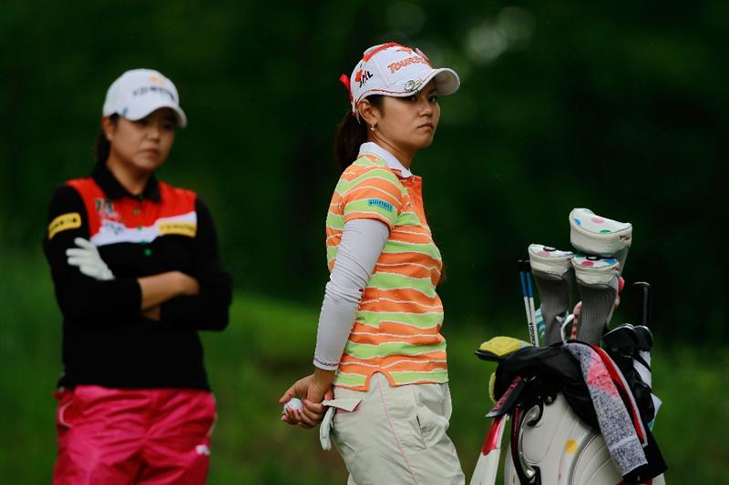 GLADSTONE, NJ - MAY 20:  Ai Miyazato of Japan (R) stands on the second tee with her opponent Hee-Won Han of South Korea (L) during round two of the Sybase Match Play Championship at Hamilton Farm Golf Club on May 20, 2011 in Gladstone, New Jersey.  (Photo by Chris Trotman/Getty Images)