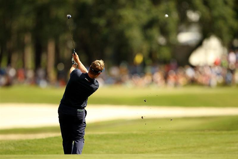 PONTE VEDRA BEACH, FL - MAY 15:  Luke Donald of England hits his approach shot on the 11th hole during the final round of THE PLAYERS Championship held at THE PLAYERS Stadium course at TPC Sawgrass on May 15, 2011 in Ponte Vedra Beach, Florida.  (Photo by Mike Ehrmann/Getty Images)