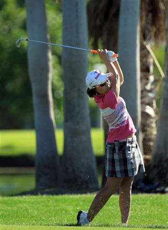 RANCHO MIRAGE, CA - APRIL 01: Mika Miyazato of Japan plays her second shot at the 18th hole during the second round of the 2011 Kraft Nabisco Championship on the Dinah Shore Championship Course at the Mission Hills Country Club on April 1, 2011 in Rancho Mirage, California.  (Photo by David Cannon/Getty Images)