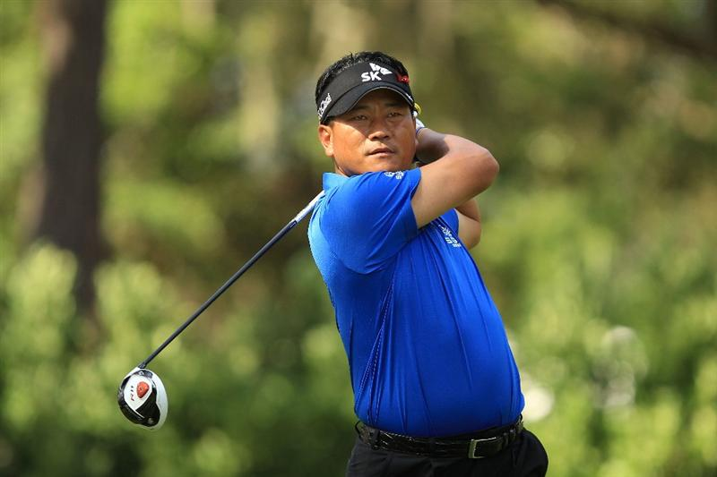 PONTE VEDRA BEACH, FL - MAY 15:  K.J. Choi of South Korea hits his tee shot on the 11th hole during the final round of THE PLAYERS Championship held at THE PLAYERS Stadium course at TPC Sawgrass on May 15, 2011 in Ponte Vedra Beach, Florida.  (Photo by Streeter Lecka/Getty Images)