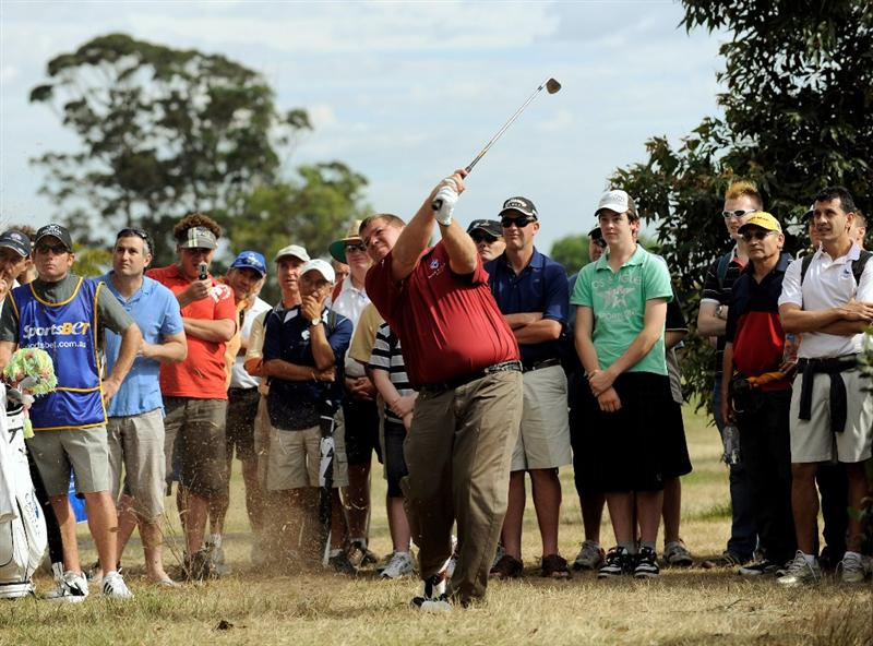 MELBOURNE, AUSTRALIA - NOVEMBER 27:  John Daly of the USA plays a shot out of the rough on the 18th hole during the first round of the 2008 Australian Masters at Huntingdale Golf Club on November 27, 2008 in Melbourne, Australia  (Photo by Robert Cianflone/Getty Images)