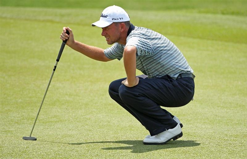 KUALA LUMPUR, MALAYSIA - MARCH 04:  Mark Foster of England lines up a putt on the 18th hole during the first round of the Maybank Malaysian Open at the Kuala Lumpur Golf and Country Club on March 4, 2010 in Kuala Lumpur, Malaysia.  (Photo by Andrew Redington/Getty Images)